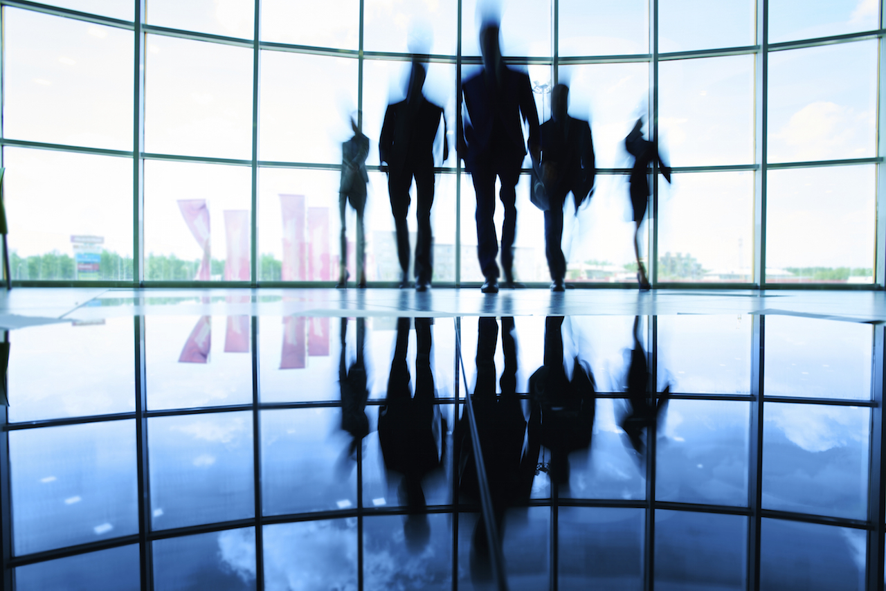 Silhouette of business team walking towards the camera